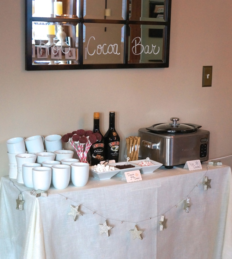 Hot cocoa bar included a crock pot of hot cocoa, Bailey's for the adults, whip cream, and various toppings, Pirouette cookies and of course, chocolate dipped marshmallows with pink sprinkles!