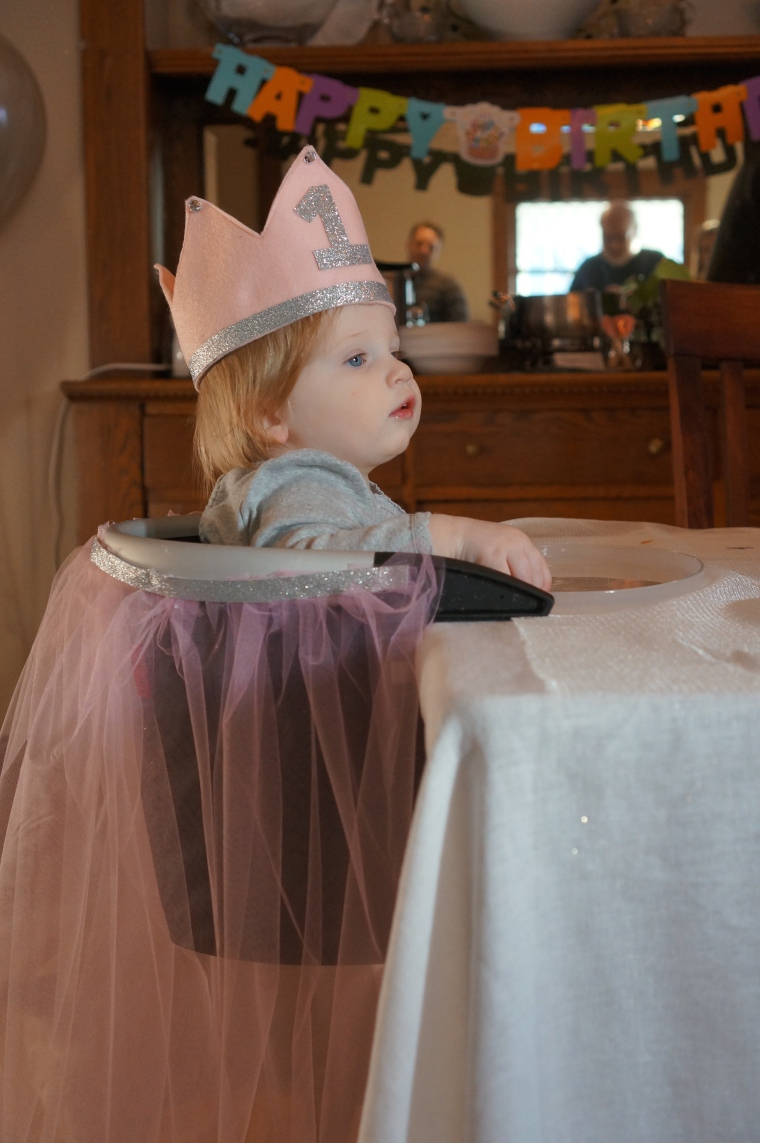 Her high chair was covered in pink tulle that I secured to her chair with a glue gun. Glue gun glue is fantastic, because it's secure, but peels right off at the end.